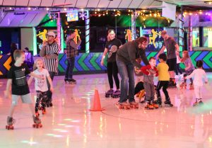 Parents and kids roller skating
