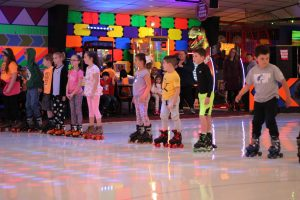 kids having fun roller skating